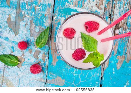 milkshake with fresh ripe raspberries