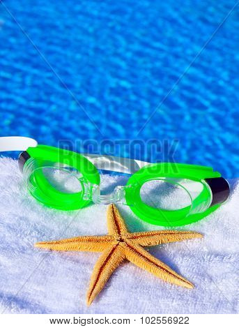 Sunglasses And Starfish On A Towel