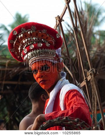 Theyyam performer preparing for a ritual in Ambilad, Kerala