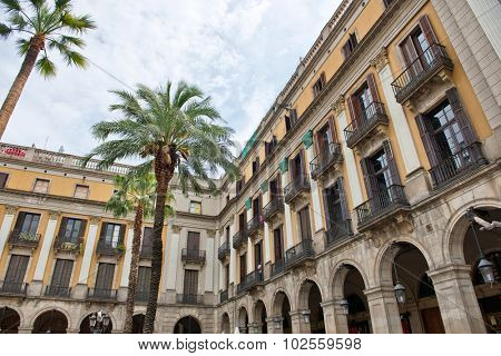 Low Angle View of Historical Buildings and Palm Trees Inside Placa Reial, a Popular Tourist Destination in Barcelona, Spain, May 02, 2015