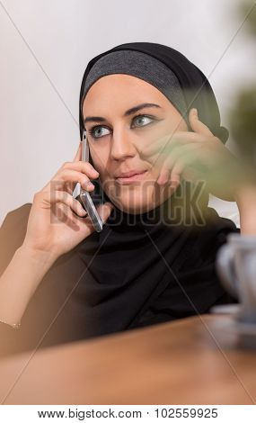 Muslim Talking On Mobilephone