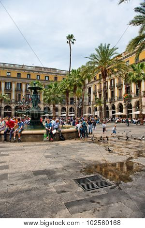 BARCELONA, SPAIN - MAY 02: Groups of Tourists Gathered Around Central Water Fountain in Placa Reial, a Popular Tourist Destination in Barcelona, Spain, May 02, 2015