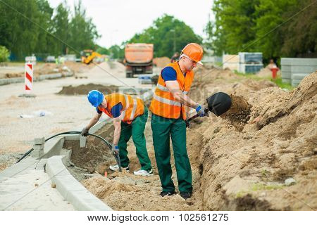 Builders On A Construction Site