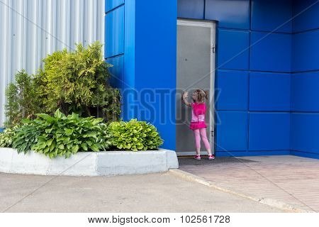 Little Girl With Tails Knocking On Steel Door