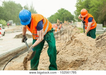 Construction Workers Digging