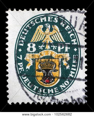 GERMAN REICH - CIRCA 1928: A stamp printed in the German Reich shows Coat of arms, Charity Stamps, circa 1928.