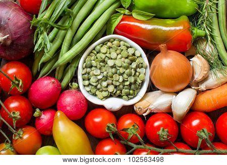 Green Peas In A Bowl Between Fresh Vegetables