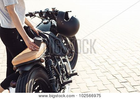 Girl With Cup Of Coffee  And Vintage Custom Motorcycle