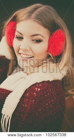 Portrait Of Pretty Smiling Woman In Red Earmuffs.