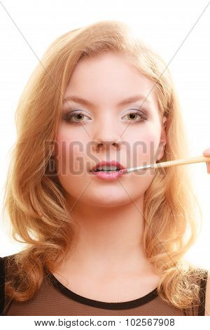 Makeup. Woman Applying Red Lipstick With Brush