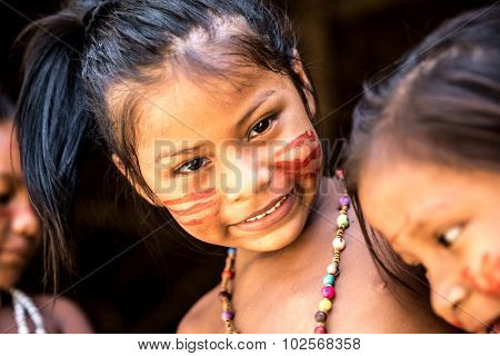 Native Brazilian girls at an indigenous tribe in the Amazon