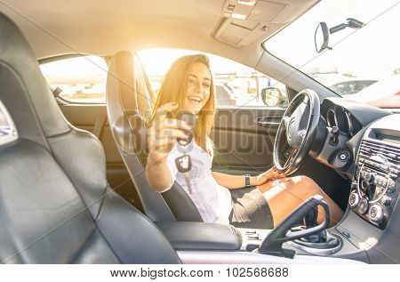 Woman Showing The Keys Inside A Sport Car.