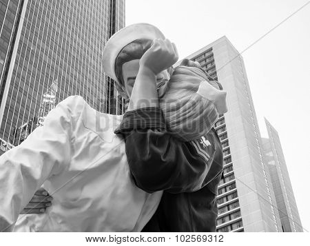 NEW YORK,USA - AUGUST 14,2015 : Figure resembling the famous photograph by Alfred Eisenstaedt of a sailor kissing a nurse at Times Square in New York City