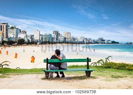 RIO DE JANEIRO - APRIL 27, 2015: Affectionate couple in love dating at Copacabana beach on April 27, 2015. in Rio de Janeiro, Brazil.