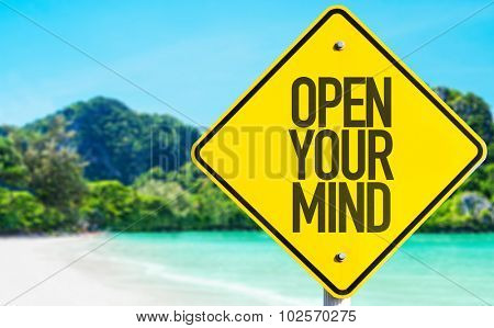 Open Your Mind sign with beach background