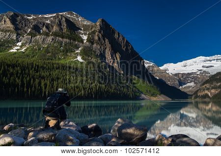 Nature Photographer Is Taking A Picture Of Lake Louise