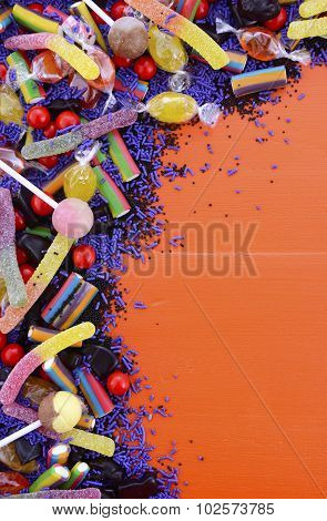 Bright Colorful Candy On Orange Wood Background.