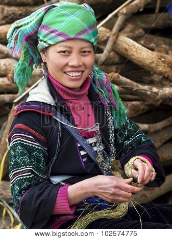Happy Hmong Woman Dressed In Traditional Attire In Sapa, Vietnam