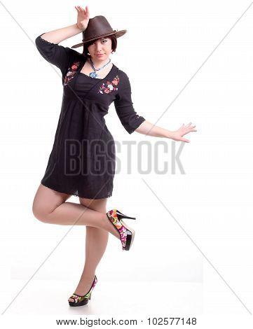 Brunette Girl Poses In Black Dress And Hat