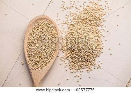 High angle view of spoon with sesame seed on the table