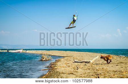 Water Fun And Kiteboarding In Ada Bojana, Montenegro, With A Dog Running Around