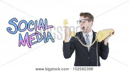 Geeky businessman shouting at telephone against social media