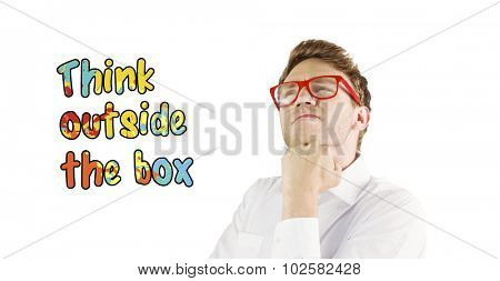 Young geeky businessman with hand on chin against think outside the box