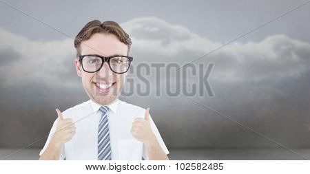 Geeky businessman with thumbs up against clouds in a room