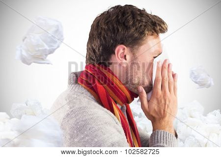Man blowing nose on tissue against white background with vignette