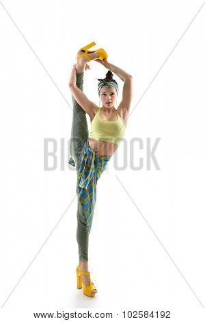 Attractive slim teen girl posing in studio. Full length portrait of young fashion woman. Fitness dancing girl. Splits.