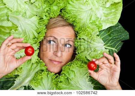Cute Woman With Salad Leaves Arranged Around Her Head Holding Small Tomatoes