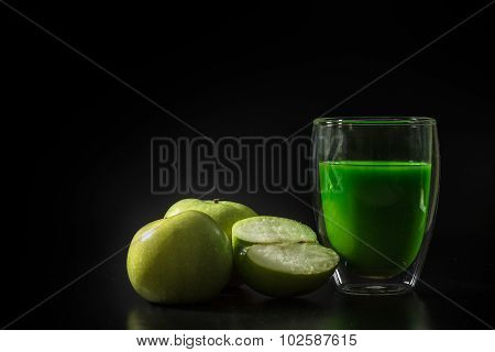 Green Apple Juice Withe Green Apples On The Black Background