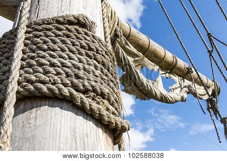Old mast and ragged rigging of a sailing ship