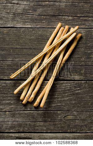 breadsticks grissini on old wooden table