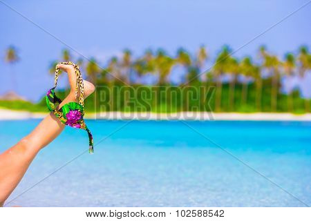 Closeup swimsuit on background of turquoise water and palmtrees