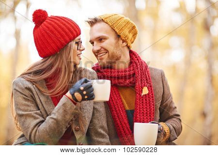 Amorous young couple having tea and rest outdoors