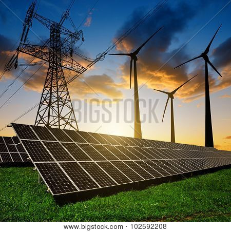 Solar panels with wind turbines and electricity pylon