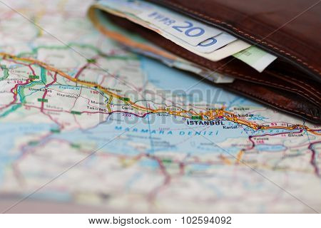 Euro Banknotes Inside Wallet On A Geographical Map Of Istanbul