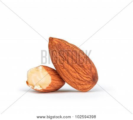 Whole And Half Almonds Isolated On White Background