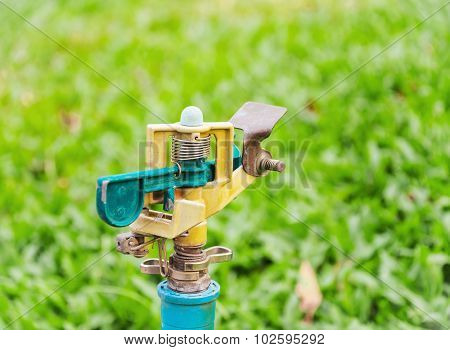 Wasting Water - Water Tap On Green Grass