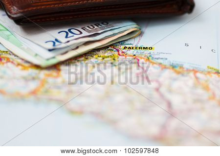 Euro Banknotes Inside Wallet On A Geographical Map Of Palermo