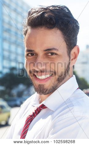 Portrait of a latin businessman in the city
