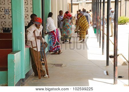 An African Boy On Crutches In The Hospital Of Iringa, Tanzania, Africa