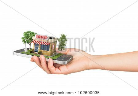 Concept Of E-commerce. Hand Holding Mobile Phone With Shop In The Display On A White Background. Onl