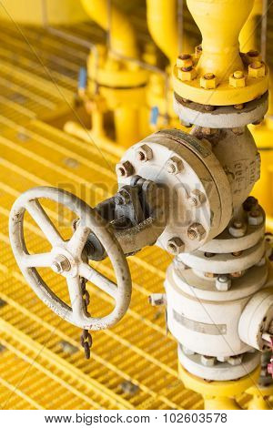 Manual valve in oil and gas industry, old valve and many rust present on the valve