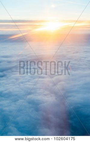 Sky and clouds air view. Looking at the sky from the window, using air transport to travel. Ray of s