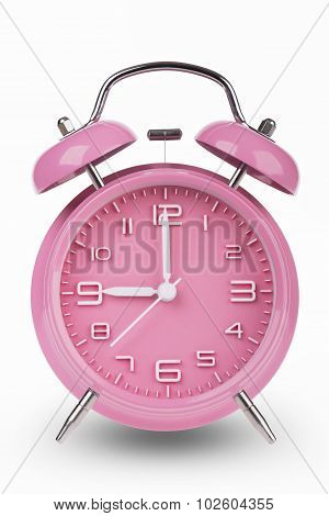 Pink Alarm Clock With Hands At 9 Am Or Pm isolated on white background