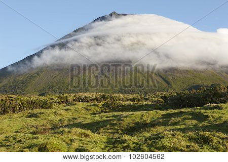 Pico Island Green Landscape With Mountain And Clouds. Azores. Portugal