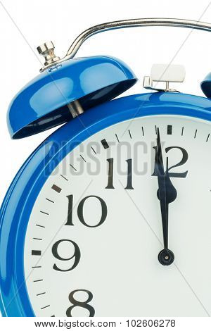 a blue alarm clock on a white background. eleventh hour