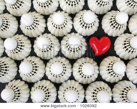 White Shuttlecocks And Red Heart